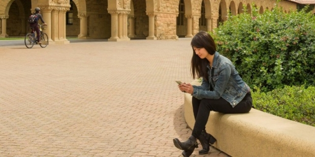 Woman viewing her mobile phone