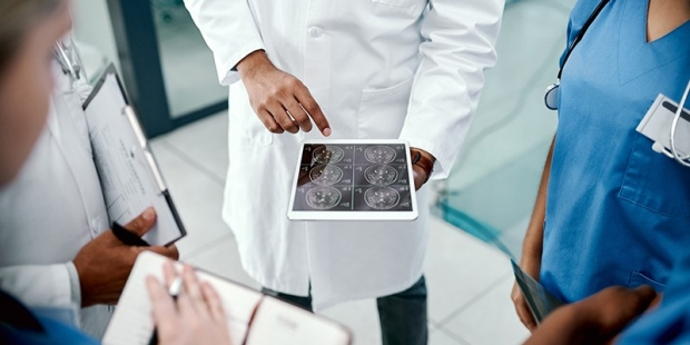Medical team viewing a touch screen